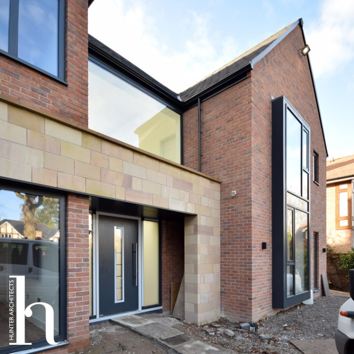 Contemporary natural stone and glazed Cheshire Brick entrance to bespoke home
