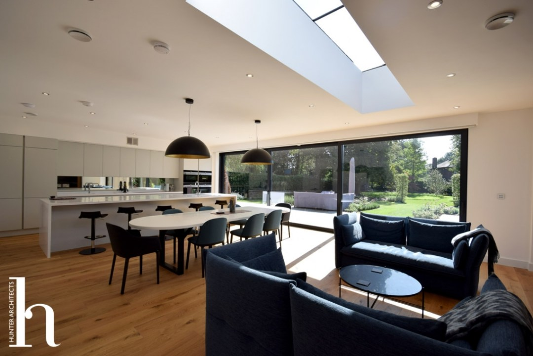 Family Room with large sliding doors and contemporary kitchen