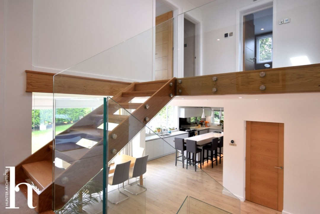 double height living space with kitchen dining and living rooms
