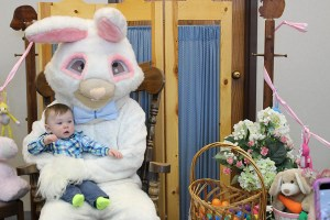 Baby in arms of Easter Bunny