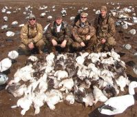 A muddy but successful early March Missouri snow goose hunt.