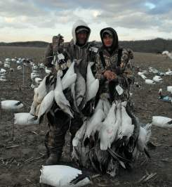 Here Up North Outdoors Guide Jim Weston (left) poses for a picture with one of his snow goose hunters.
