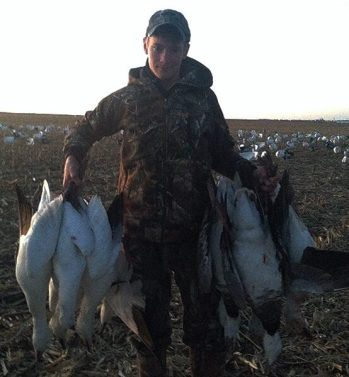 Young Hunter with Snow Geese