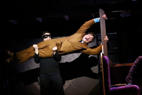 Hannay hanging of the back of the train... see, it's stage MAGIC!