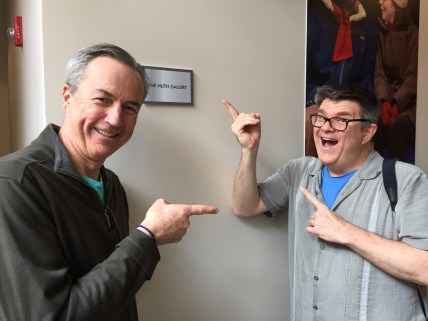 Ken Huth with Mark Cuddy of Geva Theatre acting silly with a plaque for the 'Huth Gallery'