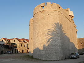 Palm tree shadows on the fortified church