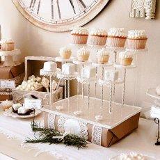 vintage winter dessert table cupcake display on pastry pedestals