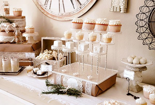vintage winter dessert table cupcake display on pastry pedestals