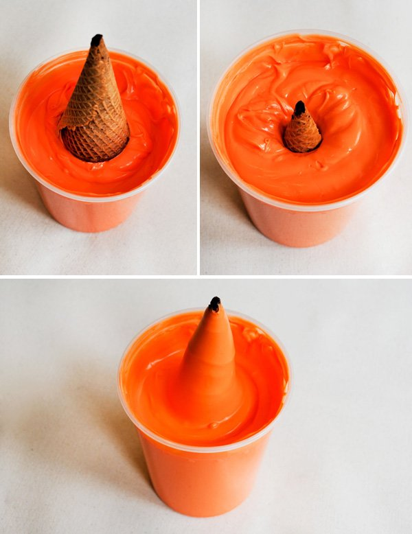 orange dipped carrot shaped cupcakes made with sugar cones and sparkles for easter with oreo dirt
