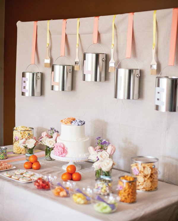 pastel art party dessert table with paint can and paint brush garland backdrop