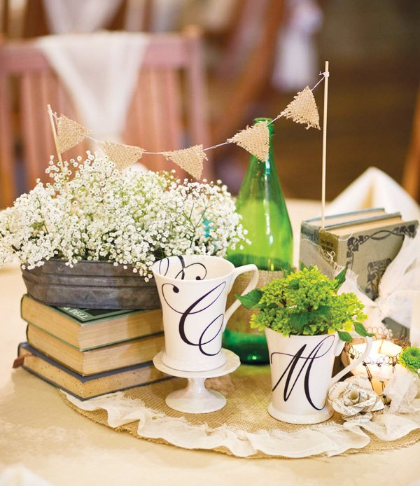 vintage wedding centerpiece with mini bunting and monogram mugs