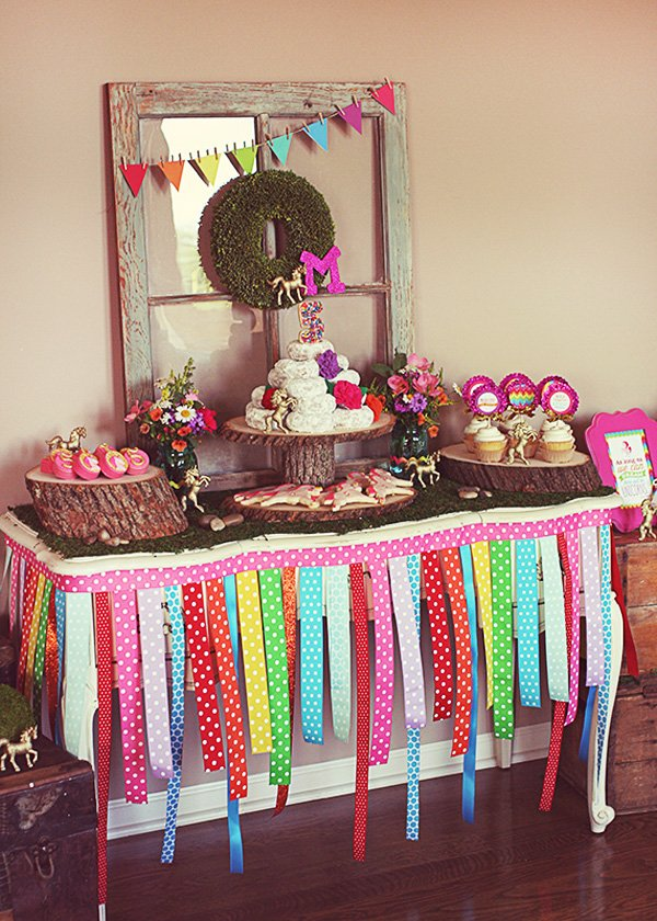 Whimsical rainbow dessert table