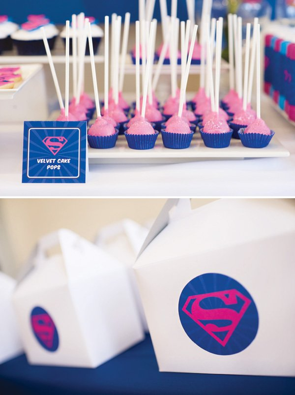 pink and blue superman cake pops and party favor boxes