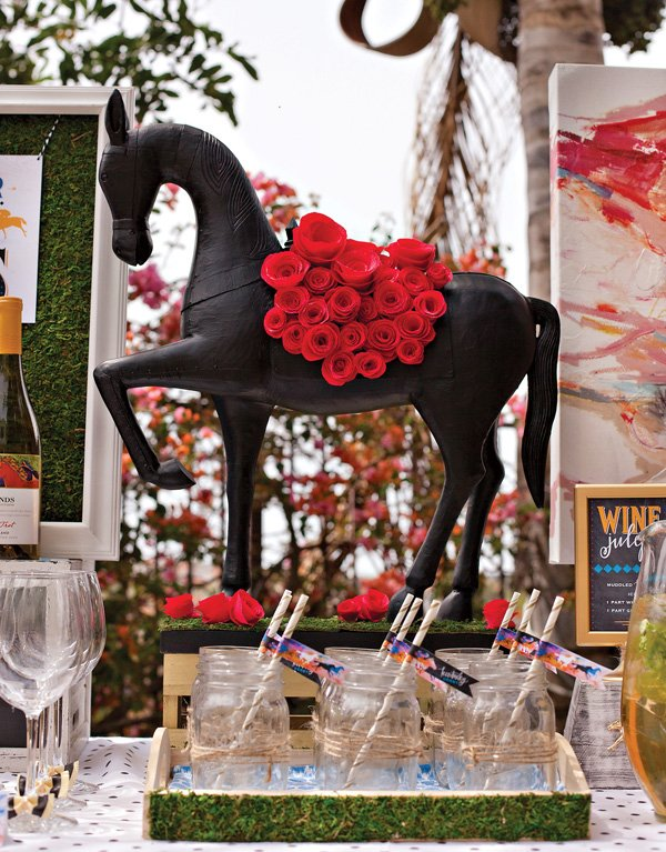 horse centerpiece with garland of crepe paper roses
