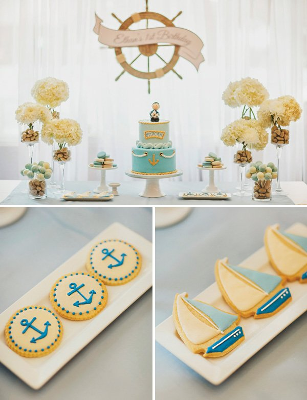 nautical themed dessert table with anchor and sail boat cookies