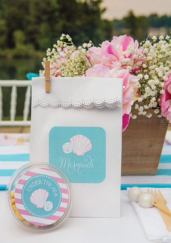 mermaid party favors and a pink and blue tablescape