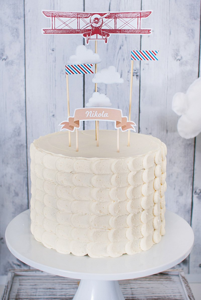 plane topped fluffy cloud birthday cake