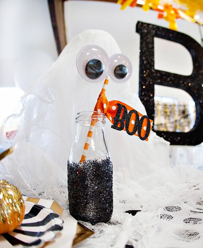 DIY Ghost with googly eyes and glittery bottle
