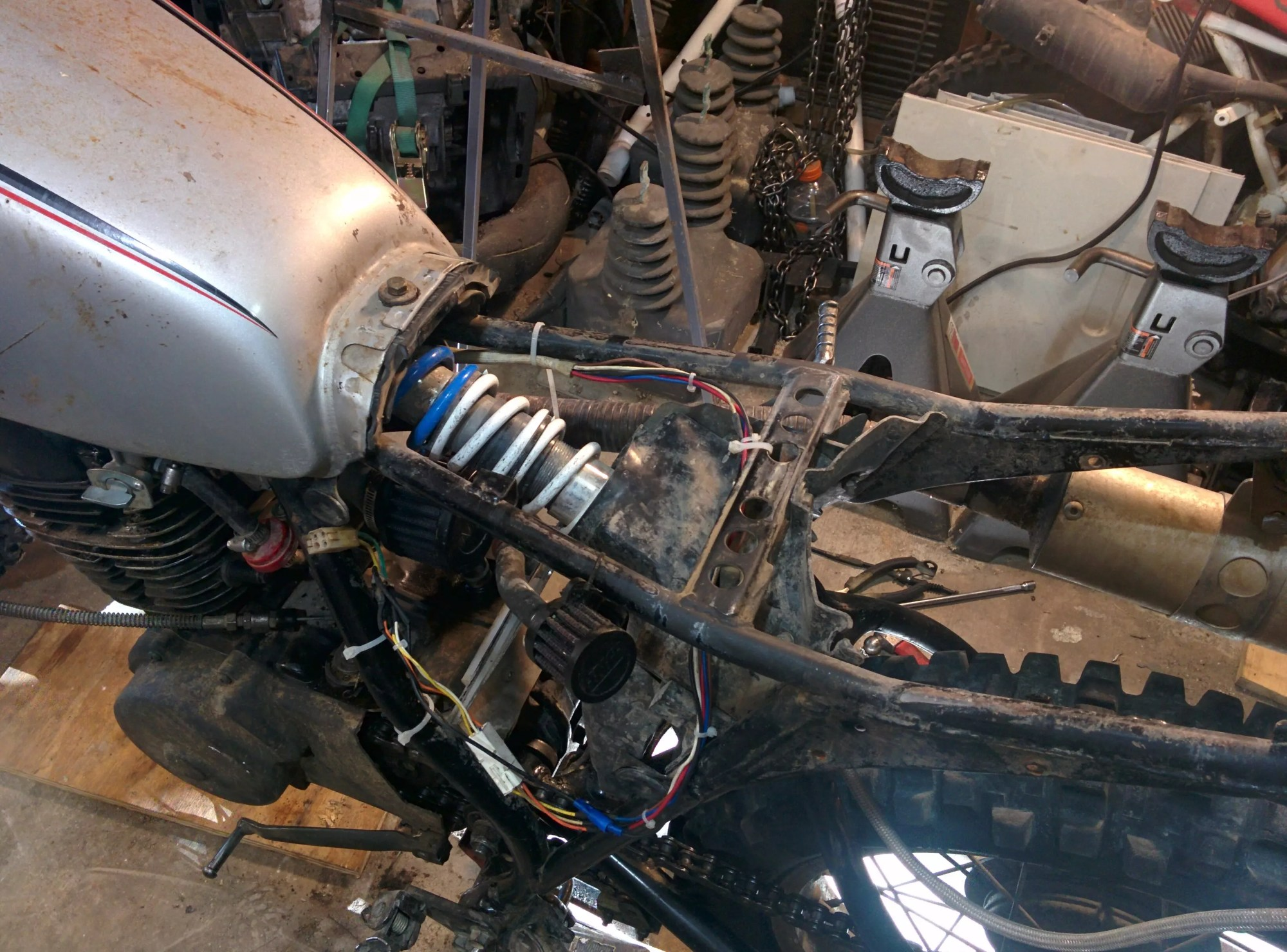 hight resolution of i took the opportunity to route the harness behind the carb and over the shock to try and keep them out of the way