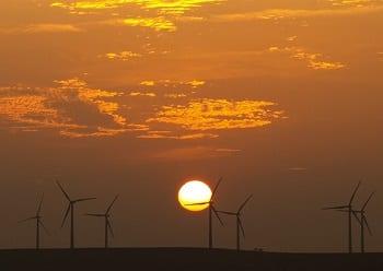 Portugal Wind Energy - Image of Wind turbines at sunset