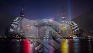 electric vehicles partnership - handshake - Shanghai, China