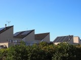 Solar energy battery storage systems - rooftop solar panels on homes