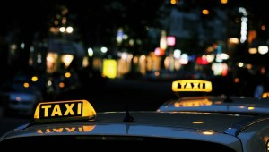 Green Tomato Cars - Taxis drving at night