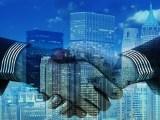 Bahrain hydrogen economy - business partnership - skyscrapers - handshake