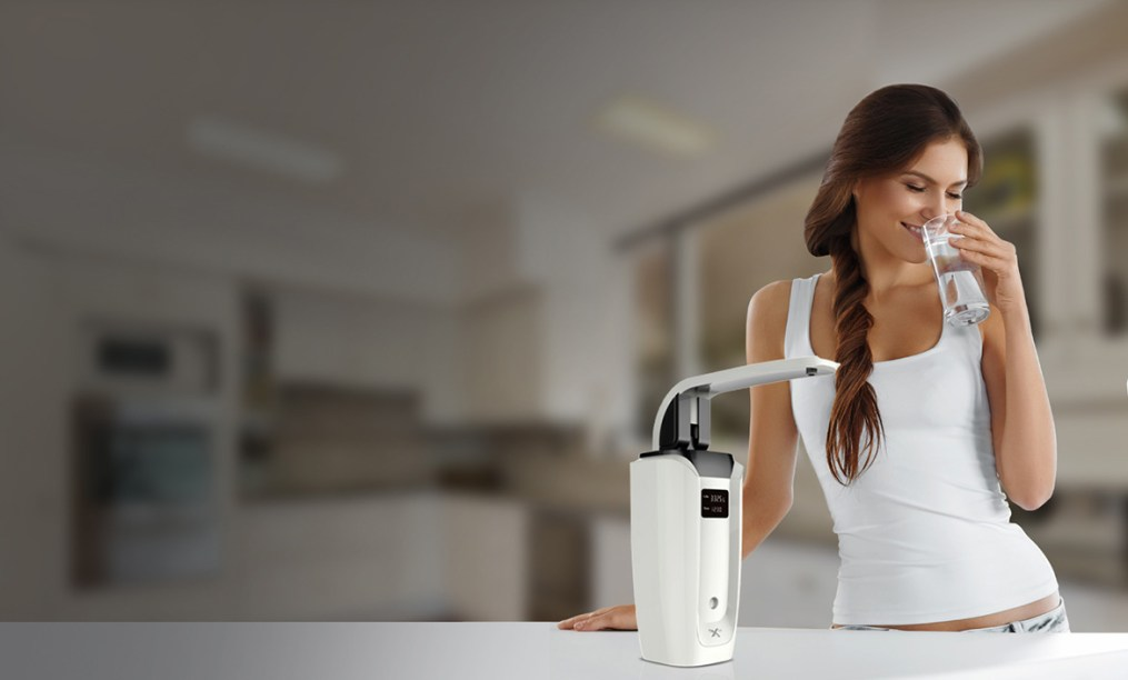 Fit Woman Drinking Hydrogen Water from HydrogenX