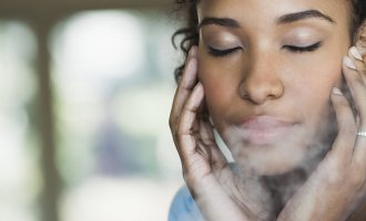 woman using humidifier