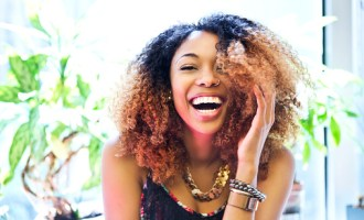 smiling woman with natural hair