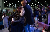 A female hairstylist cuts hair during a competition at Bronner Bros.