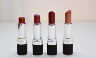 Four lipsticks lined side by side