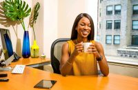 Black woman enjoying coffee