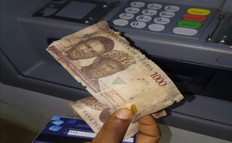Tattered money dispensed by Nigerian bank ATM machine