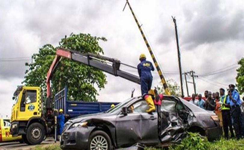 Photos: Car crushed by train in Mushin