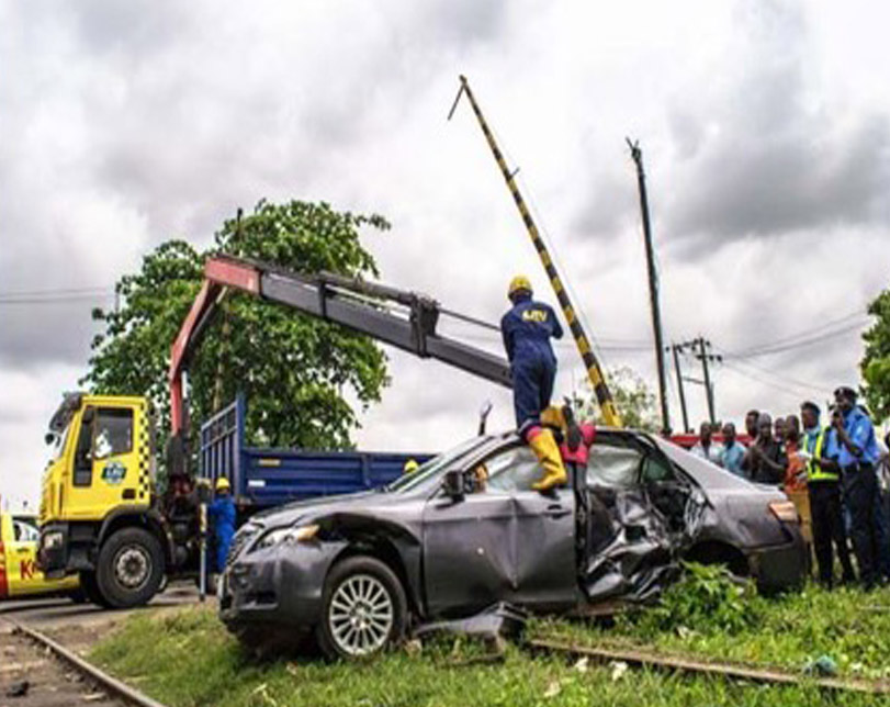Photos: Car crushed by train in Mushin