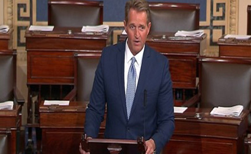 US Senator Jeff Flake blasts Donald Trump in blistering speech