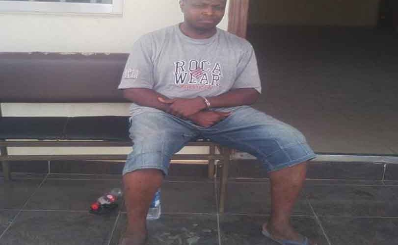 Police release photos of arrested journalist, Daniel Elombah, in handcuff