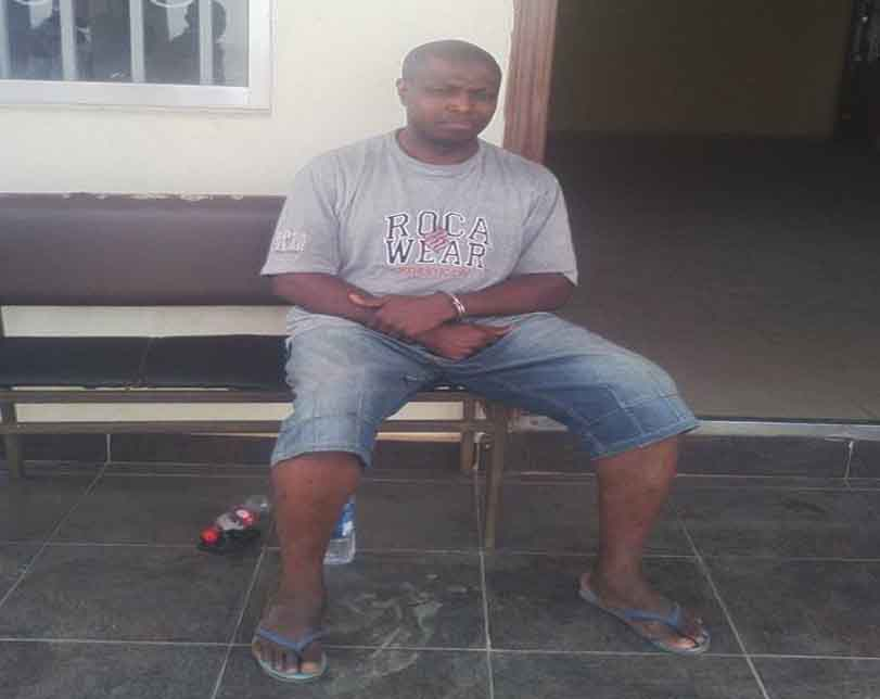 Police release photos of arrested journalist, Daniel Elombah, in handcuff