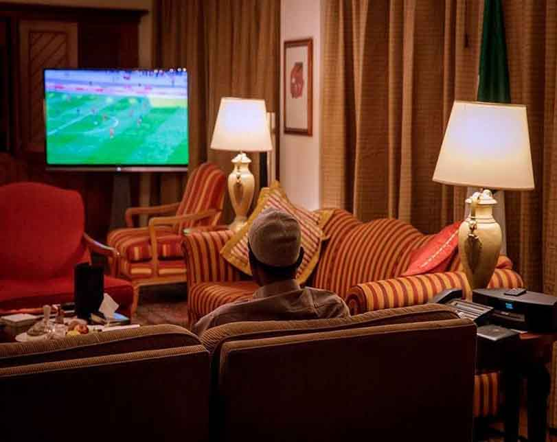 President Buhari watching the Super Eagles match against Angola