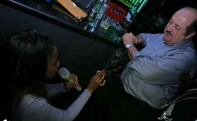 Photos: Young black lady gets down on her knees in public to propose to her older white lover