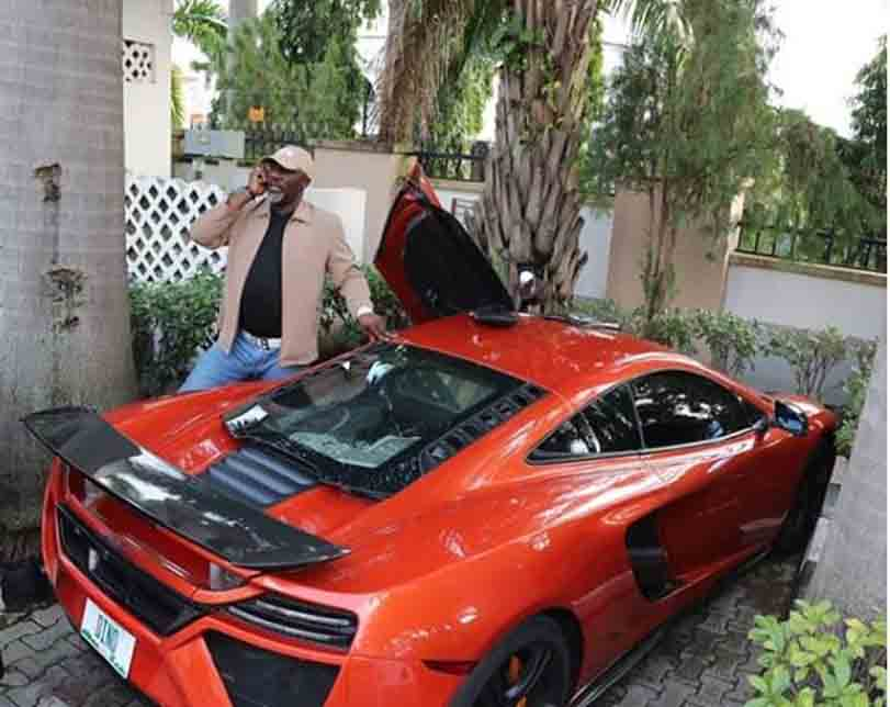 Dino Melaye Poses Beside His Red Ferrari Car After Failing To Appear In Court (Photo)