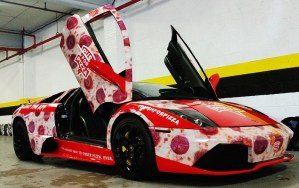 A car wrapped to look like pepperoni pizza!