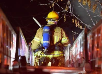 Fire fighter on a ramp about to put out a fire