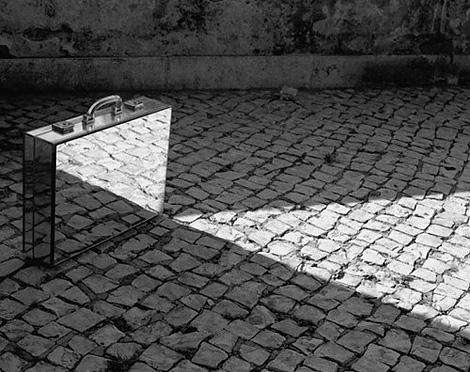 Mirror Suitcase Man