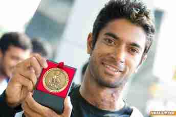 CS Santosh with Dakar medal