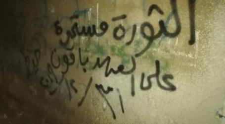 تمزيق صور بشار الأسد في مدينة درعا وإحراق مبنى إحدى البلديات