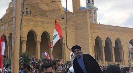 اللبنانيون المتظاهرون غاضبون ويعلقون مشنقة حسن نصر الله في بيروت