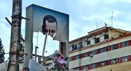 تمزيق صور بشار الأسد في محيط دمشق